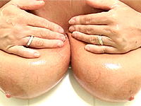 Great slippery mature breasts getting all wet.